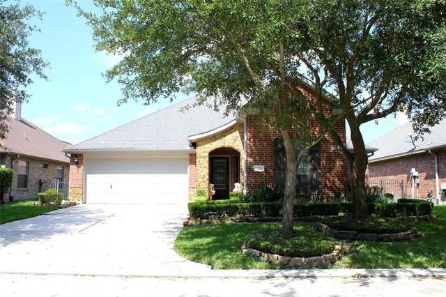 22124 Lancelot Oaks Drive, Kingwood, TX 77339 (MLS #76437003) :: The Parodi Team at Realty Associates