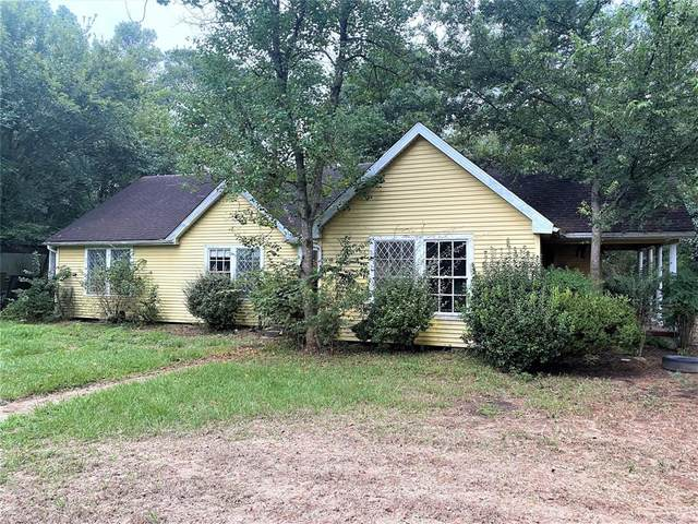 712 Plum Grove Road, Cleveland, TX 77327 (MLS #76702137) :: All Cities USA Realty