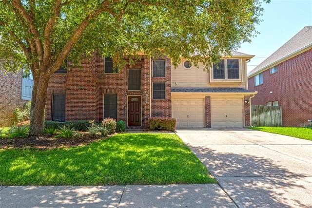 16407 Ash Point Lane, Sugar Land, TX 77498 (MLS #76849382) :: The SOLD by George Team