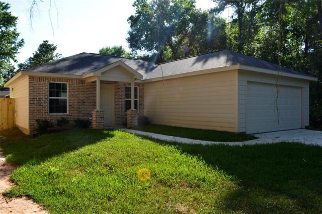 15105 Travis Lane, Willis, TX 77378 (MLS #77181479) :: Fine Living Group