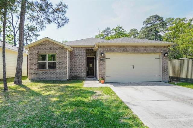 10915 Longleaf Drive, Conroe, TX 77385 (MLS #77208078) :: Ellison Real Estate Team