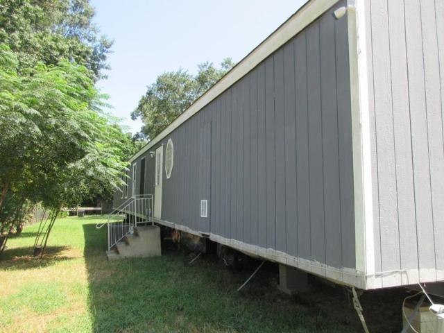 706 Pine Hill, Pinehurst, TX 77362 (MLS #77340526) :: Giorgi Real Estate Group
