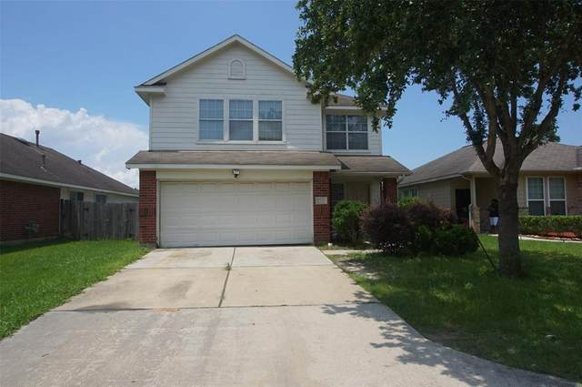 12531 Meadow Frost Lane, Houston, TX 77044 (MLS #79429399) :: The SOLD by George Team