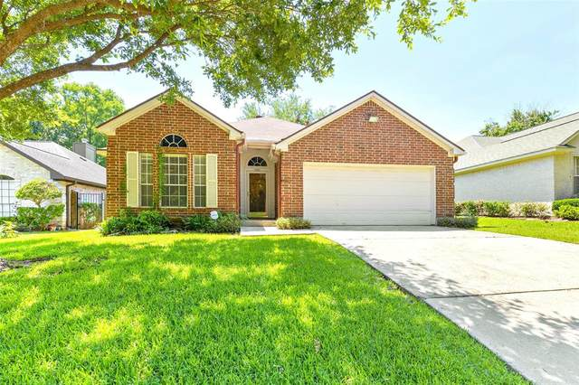 5061 Lakeshore Drive, Willis, TX 77318 (MLS #80351657) :: The Home Branch
