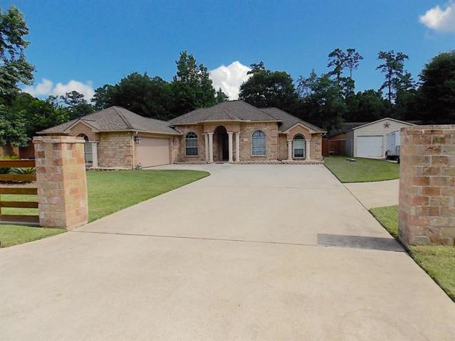 12222 Pine Shadows Lane, Pinehurst, TX 77362 (MLS #80879132) :: Grayson-Patton Team