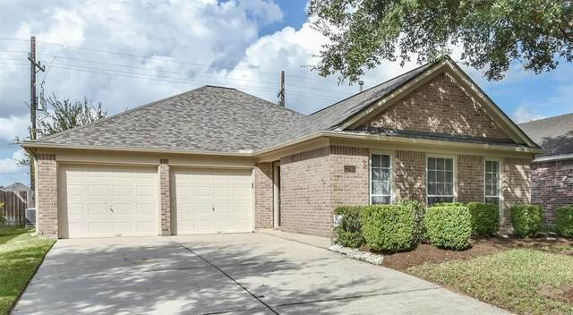 22012 Knights Cove Drive, Kingwood, TX 77339 (MLS #82204278) :: The Sansone Group