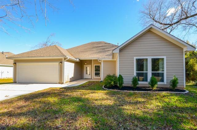 15220 Paradise View Dr, Willis, TX 77318 (MLS #82363943) :: Texas Home Shop Realty