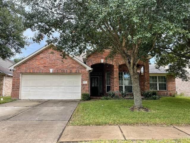 26033 Castle Meadow Lane, Kingwood, TX 77339 (MLS #82434852) :: Caskey Realty