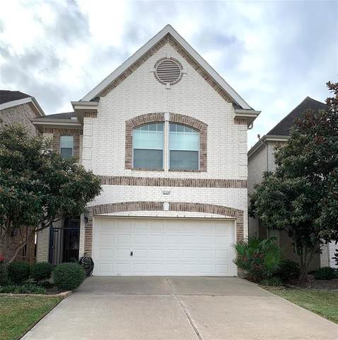 14427 Basalt Lane, Houston, TX 77077 (MLS #83545960) :: Michele Harmon Team