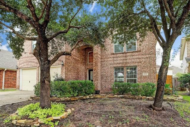 8214 Point Pendleton Drive, Tomball, TX 77375 (MLS #83757504) :: The Parodi Team at Realty Associates