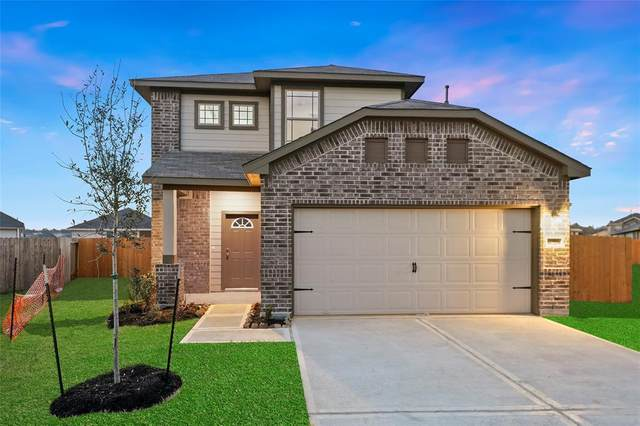 14215 Grand Hills Drive, Conroe, TX 77303 (MLS #83921973) :: Michele Harmon Team