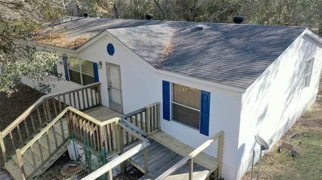 19747 Village Forest, Montgomery, TX 77356 (MLS #84051893) :: Caskey Realty
