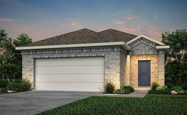 835 Redinger Ridge Drive, Huffman, TX 77336 (MLS #8419715) :: The Freund Group