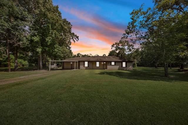 12 Magnolia Lane, Huffman, TX 77336 (MLS #86129596) :: The Bly Team