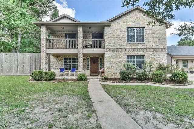 606 W Rollingwood Street, Pinehurst, TX 77362 (MLS #86499949) :: The Home Branch
