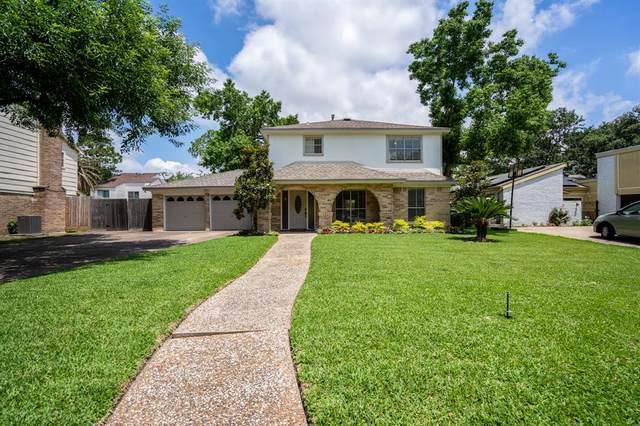 13910 Ella Lee Lane, Houston, TX 77077 (MLS #88151988) :: The Parodi Team at Realty Associates