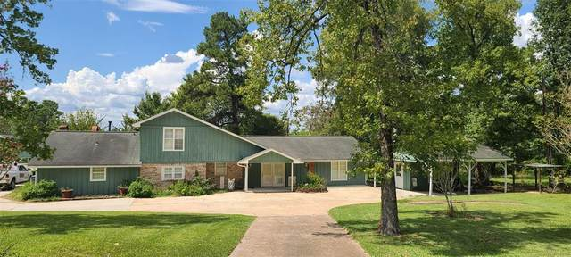 12223 Thompson Road, Willis, TX 77318 (MLS #88179475) :: The SOLD by George Team