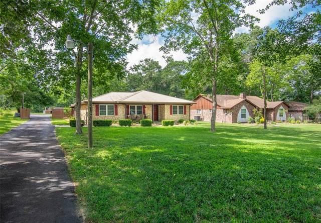 13702 Calhoun Road, Conroe, TX 77302 (MLS #89363464) :: Caskey Realty