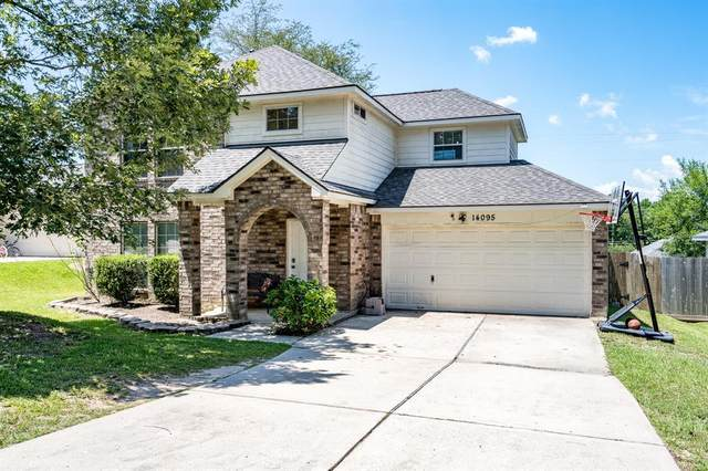 14095 Running Bear Drive, Willis, TX 77378 (MLS #90084874) :: Ellison Real Estate Team