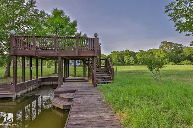 4 Wilderness Trail, Huntsville, TX 77340 (MLS #90990916) :: The Freund Group