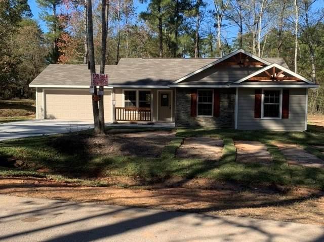 10665 Royal Cavins, Conroe, TX 77303 (MLS #91903886) :: The Property Guys