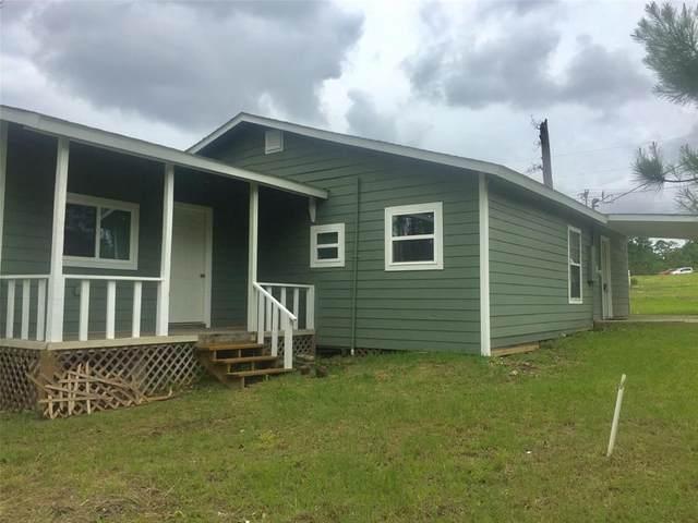 144 Magnolia Cove, Onalaska, TX 77360 (MLS #92596063) :: Keller Williams Realty