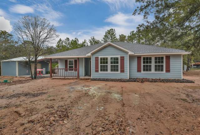 14 Raccoon Bend, New Waverly, TX 77358 (MLS #92669960) :: The SOLD by George Team