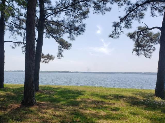 9100 Escondido Drive, Willis, TX 77318 (MLS #92919049) :: My BCS Home Real Estate Group