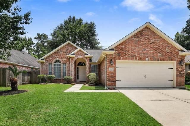 1710 Whispering Forest Drive, Kingwood, TX 77339 (MLS #93269631) :: The Parodi Team at Realty Associates