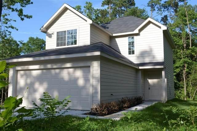 15006 Austin Road, Willis, TX 77378 (MLS #93576654) :: Johnson Elite Group