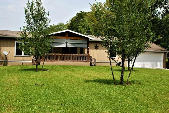 1410 Lakeside Drive, Huntsville, TX 77320 (MLS #94547062) :: The Parodi Team at Realty Associates