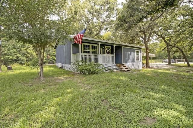 5516 Leaning Oaks Lane, Madisonville, TX 77864 (MLS #94983591) :: The Bly Team