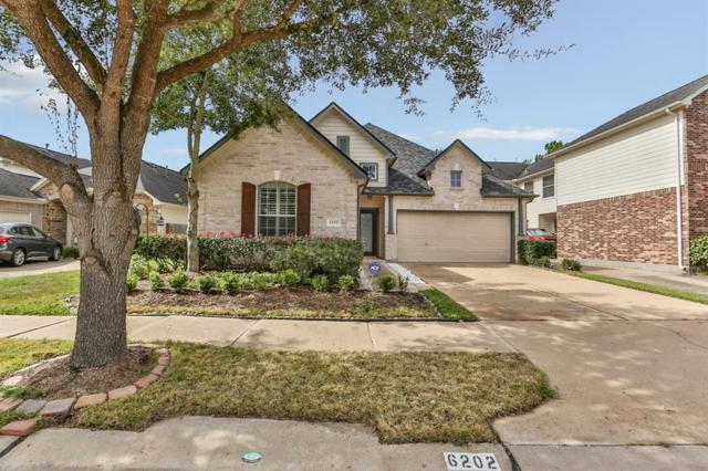 6202 Breezy Hollow Lane, Katy, TX 77450 (MLS #95822385) :: The Bly Team