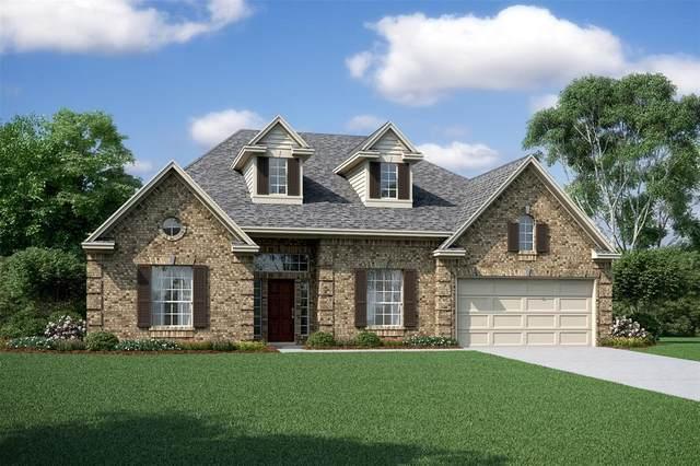 11806 Oakwood Drive, Mont Belvieu, TX 77535 (MLS #96251666) :: Christy Buck Team