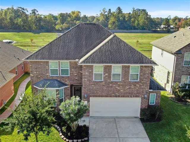 21438 Kirsten Falls Drive, Porter, TX 77365 (MLS #97158128) :: Ellison Real Estate Team