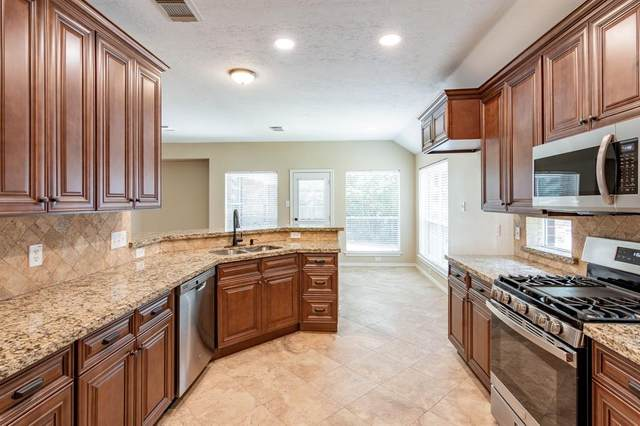 130 W Russet Grove Circle, The Woodlands, TX 77384 (MLS #97533341) :: Michele Harmon Team