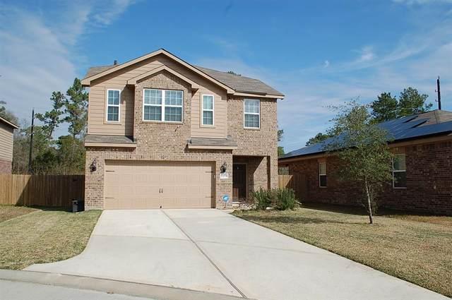 12078 Quartersawn Lane, Pinehurst, TX 77362 (MLS #98616810) :: TEXdot Realtors, Inc.