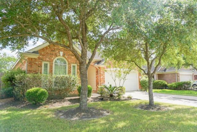 12008 Green Falls Drive, Pearland, TX 77584 (MLS #12809485) :: Texas Home Shop Realty