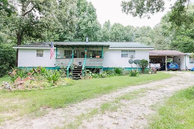 301 Saddle Surrey Road, Coldspring, TX 77331 (MLS #24539505) :: My BCS Home Real Estate Group