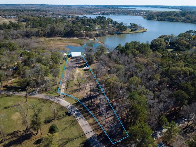 13561 Enchanted Cove Drive, Willis, TX 77318 (MLS #29579215) :: The SOLD by George Team