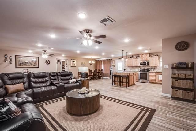 26 Center Hill Road, Oakhurst, TX 77359 (MLS #35482840) :: The Property Guys