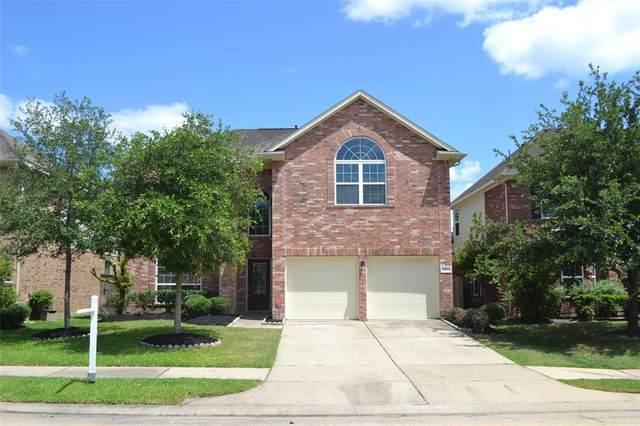 24423 Ranchwood Springs Lane, Katy, TX 77494 (MLS #51667090) :: The SOLD by George Team