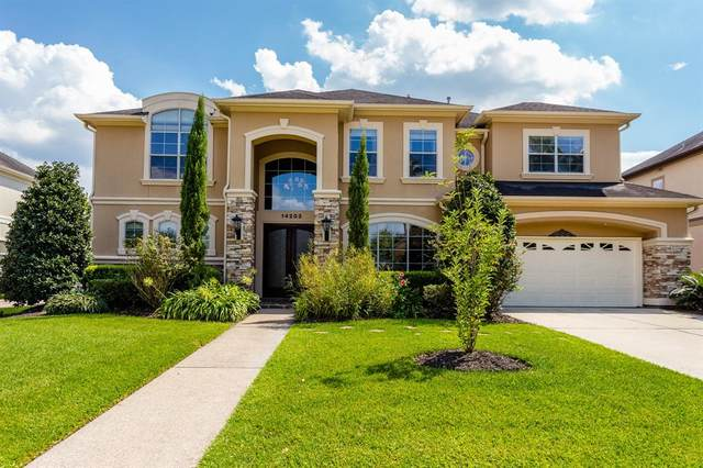 14203 Jade Cove Drive, Houston, TX 77077 (MLS #52856939) :: My BCS Home Real Estate Group