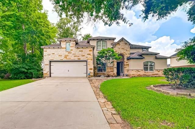 6688 Kingston Cove Lane, Willis, TX 77318 (#57825274) :: ORO Realty