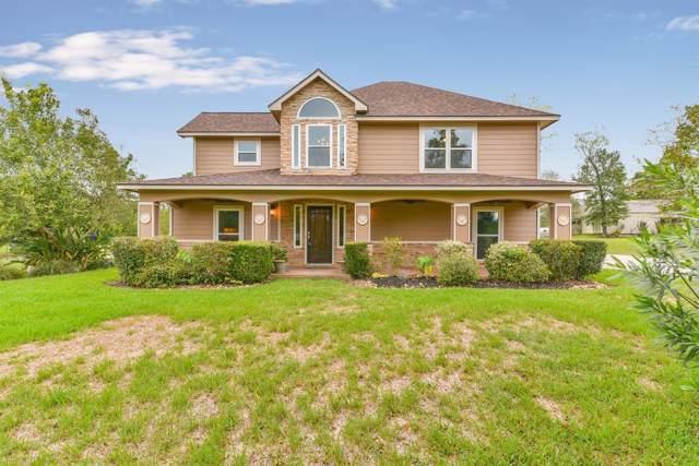 9195 Grand Lake Estates Drive, Montgomery, TX 77316 (MLS #60909480) :: The Home Branch