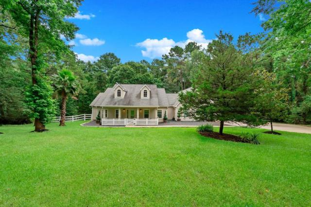 1818 Country Creek Court, Magnolia, TX 77354 (MLS #73372353) :: The SOLD by George Team