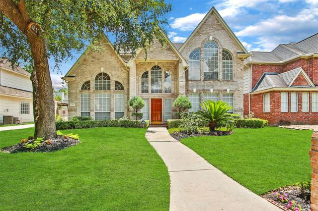 7911 Tizerton Court, Spring, TX 77379 (MLS #74143369) :: The SOLD by George Team