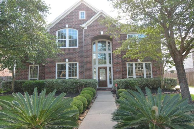 13007 Old Windmill Dr, Richmond, TX 77407 (MLS #81244940) :: The SOLD by George Team