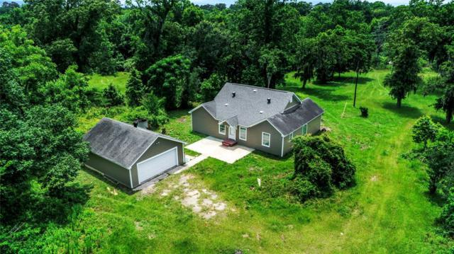 423 Pin Oak Lane, Magnolia, TX 77354 (MLS #13070273) :: Texas Home Shop Realty