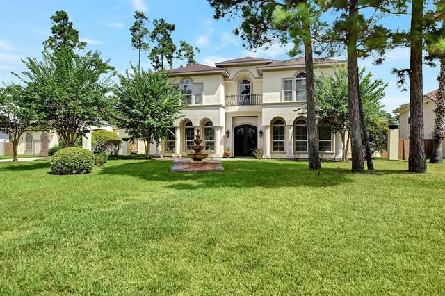 38 Oak Cove Lane, Kingwood, TX 77346 (MLS #81013374) :: All Cities USA Realty